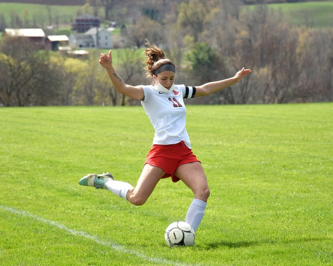 Ashley Engle boots the ball up the field for Oppenheim-Ephratah-St. Johnsville Saturday at Fort Plain. Engle scored two goals in a 7-0 win for the unbeaten Wolves.