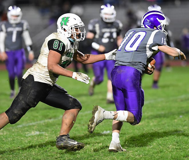 Herkimer Magician Andre McNair (81) grabs a Little Falls ball-carrier from behind Saturday, April 17, 2021, in Little Falls, New York.