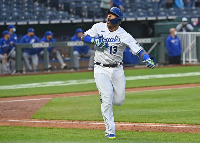 Kansas City Royals designated hitter Salvador Perez (13) reacts after hitting a walk off home run against the Toronto Blue Jays at Kauffman Stadium. The Royals won 3-2 to split a doubleheader after Friday's game was postponed because of rainy weather.