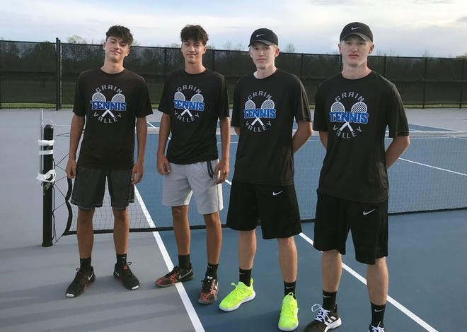 Twins Carter and Kade Compton and Connor and Collin Smith, from left to right, keep things interesting for coach Randy Draper and their Grain Valley High School tennis teammates. Draper and many of their fellow Eagle teammates admit that the only way they can tell the twins apart is by their shoes.