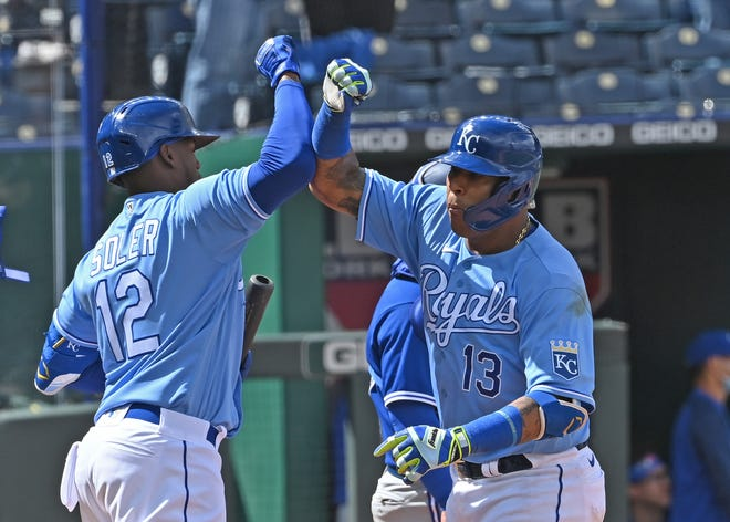 Royals catcher Salvador Perez (13) celebrates with Jorge Soler (12) after hitting a two-run home run during the seventh inning against the Toronto Blue Jays Sunday at Kauffman Stadium. The Royals went on to a 2-0 win.