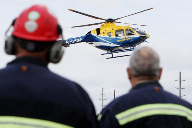 A MedForce helicopter lands Monday during an Iowa Fertilizer Co. safety training session at the Wever facility. IFC has been running a series of safety and response trainings throughout April to help prepare team members in the event an incident occurs there.