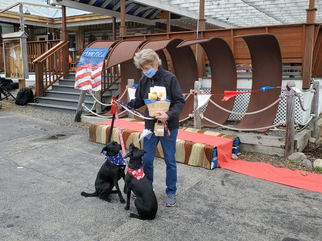 Kate Sullivan of Cape Neddick, Maine, and her dogs Casey and Winnie took second place in the Patriotic Pooch Pageant, hosted by the Ogunquit Chamber of Commerce, on Sunday, April 18, 2021.