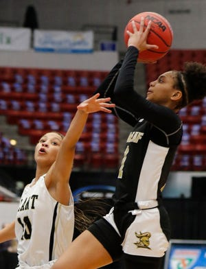 Oakleaf guard Taliah Scott (1) elevates to shoot against Tampa Plant during the FHSAA Class 7A girls basketball state semifinal.