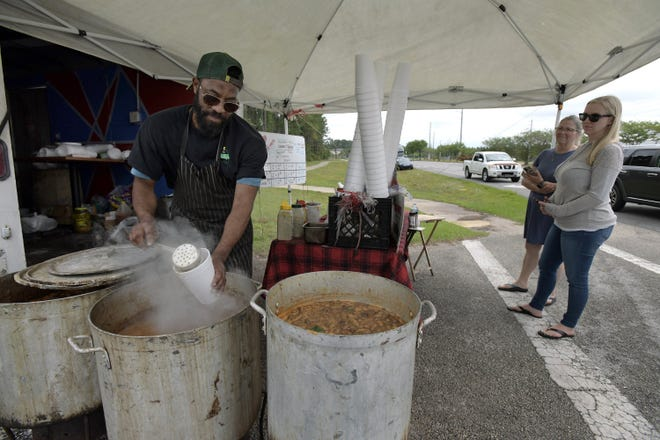 Randy Waters serves up his specialty boiled peanuts from his roadside stand at the eastern end of Racetrack Road on Saturday, April 17.  After five years selling his peanuts roadside, he's opened a brick-and-mortar restaurant, Randeez Nutz Express, at 14985 Old St. Augustine Road.