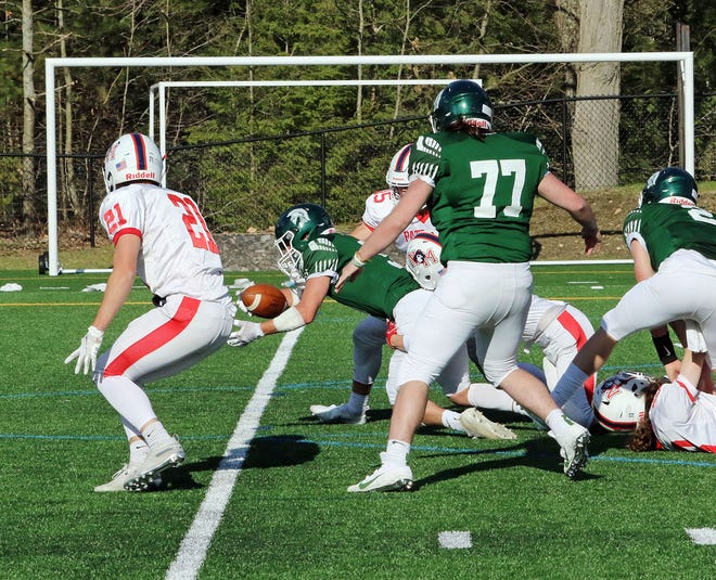Oakmont's Ryan McKenna stretches the ball across the goal line while scoring on a 10-yard run in the first quarter of Sunday's game against North Middlesex at Arthur I. Hurd Memorial Field in Ashburnham. Also pictured are North Middlesex's Tallon Craver (21) and Oakmont's Robert Lowe (77).