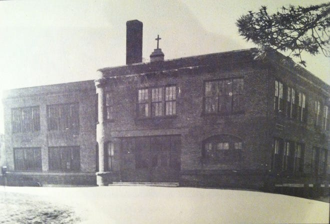The original Sacred Heart School building, with its ornate and foreboding look, was razed in 1980.