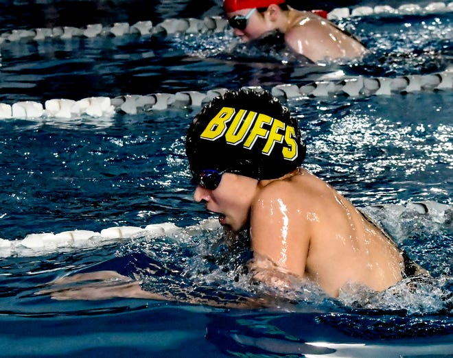 Garden City High School's Lana Rodriguez comes up for a breath and stroke in the 200-yard IM April 13 at the Garden City Family YMCA.