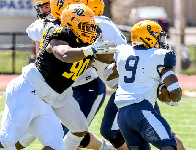 Garden City Commnity College defensive tackle Eilye-Oshaye Hill drops Highland running back Chris Jones for a loss in the Scotties' backfield April 10 at Broncbuster Stadium. The Broncbusters picked up a road win Saturday at Indepedence to move to 4-0.