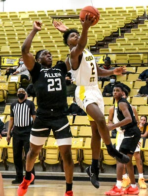 Garden City Community College's Denver Jones, right, drives past Allen County's Amadou Traore for a basket during a February game at Perryman Athletic Complex.