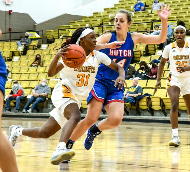 Garden City Community College's Donetria McGee, left, drives the lane past Hutchinson's Kate Ogle for a basket during a March 6 game at Perryman Athletic Complex.