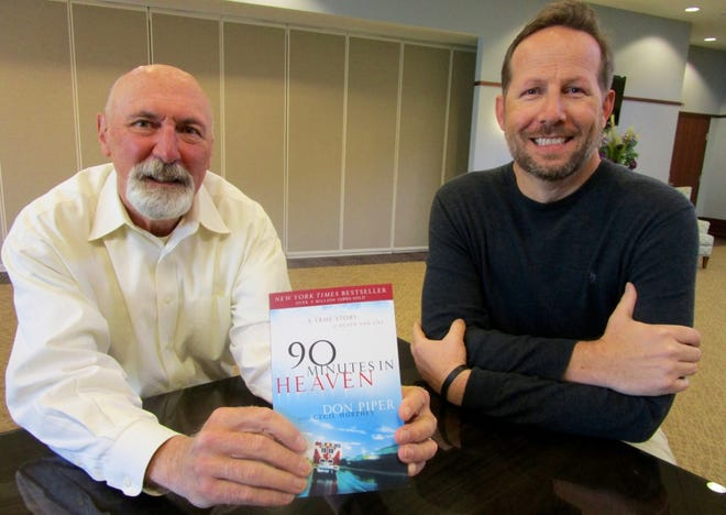 """Brent Boxell, left, and Tim Brinkman, representing First United Methodist Church in Geneseo, show a copy of """"90 Minutes in Heaven,"""" written by Don Piper, who will share his testimony via live stream on Tuesday, May 4, at First United Methodist Church in Geneseo."""