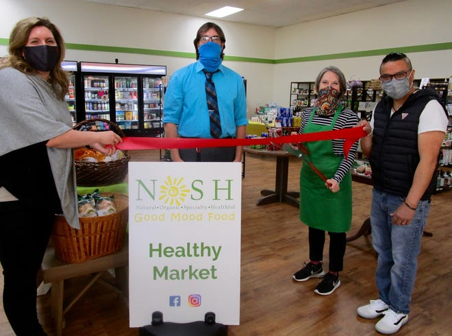 Bethany Winkleman, left, State Farm Insurance Agent in Geneseo; Zack Sullivan, executive director of the Geneseo Chamber of Commerce; Tina and Patrick Hernandez, are shown at the recent ribbon cutting for NOSH, owned and operated by the Hernandez couple. NOSH (Good Mood Food) is an acronym for natural, organic, specialty, healthful items. The store carries all types of food items, such as gluten-free, organic, dairy-free, vegan, all-natural; in addition to supplements, CBD, pet foods, non-toxic cleaning supplies, personal and beauty items, essential oils and other holistic items, gifts and gift baskets. The shop, at 804 South Oakwood Dr. in Geneseo, is open from 10 a.m. to 6 p.m. on Monday; 10 a.m. to 5 p.m. Tuesday through Friday, and from 10 a.m. to 2 p.m. on Saturday For more information about NOSH, call 309-945-8624 or visit the website, Face book or Instagram @noshgeneseo.