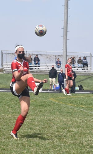 Orion-Sherrard's Hailey James juggles the ball on Saturday, April 17, at Charger Field. It was a once-in-a-century opportunity for the boys and girls teams to play on the same day, thanks to a pandemic forcing the boys team to delay its season until the spring. Saturday was the season finale for the boys and the season opener for the girls, and both played Monmouth-Roseville