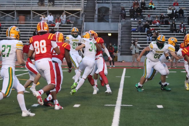 Geneseo's Green Machine scores a victory, 23-15, over the Rock Island Rocks at Rock Island on Friday, April 16.