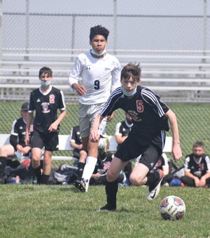 Orion-Sherrard's Luke Moen pursues the ball during a match with Monmouth-Roseville on Saturday, April 17, at Charger Field. It was a historic day for United because both the boys and girls teams were able to play on the same day. To make that happen took a pandemic forcing boys soccer, a fall sport, into the spring season.