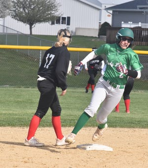 Geneseo's Payton Stohl rounds second as Orion shortstop Marly Lillibridge waits for the ball on Thursday afternoon, April 15, at the Charger diamond.