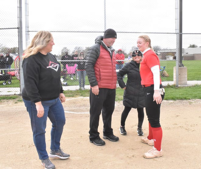 Orion's Jenna Drish celebrates senior night with her family before the varsity softball team plays its season opener on Thursday, April 15, at the Charger field.