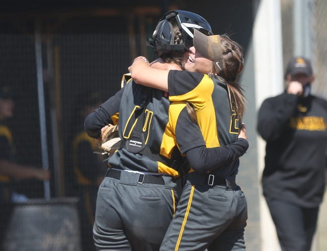 FHSU's Hailey Chapman, right, hugs catcher Sara Breckbill after Chapman tossed a complete-game shutout in Game 2 of Sunday's doubleheader with Missouri Western.