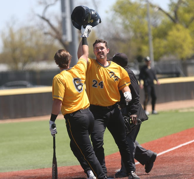 FHSU's Garrett Stephens is greeted by Kade Wallace after Stephens hit a home run on Sunday against Northwest Missouri State.