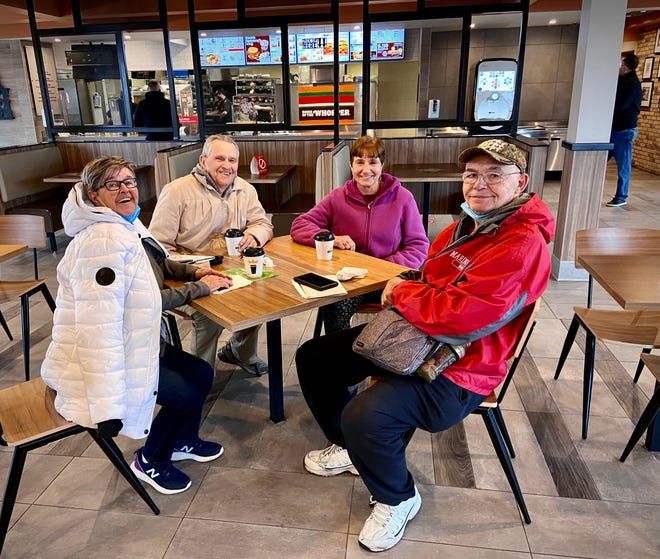 Ray Ferreira of Tiverton, far right, is seen here, from left, with friends Sandy Parquette, Bob Barlow and Dolores Mello inside the remodeled dining room of the Canning Boulevard Burger King in Fall River.