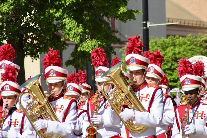 Members of the Holland Christian High School Marching Band march during the Holland Memorial Day Parade on Monday, May 27, 2019. Organizers have canceled the parade in 2021, citing concerns over COVID-19 (Sentinel File)