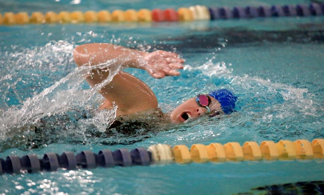 Hutchinson's Claire Fee competes in the 200 yard freestyle during the Buhler Invitational swim meet Saturday at the YMCA.