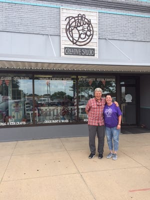 Jon Schallert (left), President of The Schallert Group, and Phyllis Brack, owner of Dilly & Doc Creative Studio, stand outside Brack's storefront at 1119 Main Street in Great Bend, during a site visit in 2019, just months after Brack attended the Destination BootCamp seminar to learn how to make her store a retail destination and success.