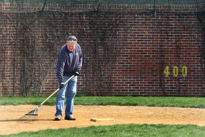 Jeff Williams rakes the field at second base during a cleanup day at Little Cubs Field on Saturday, April 17, 2021, in Freeport.