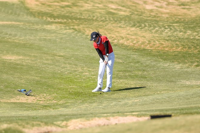Lubbock-Cooper's Ayers Finley hits a chip during the Region I-5A girls' golf tournament on Monday, April 19, 2021 at Rawls Golf Course in Lubbock, Texas.