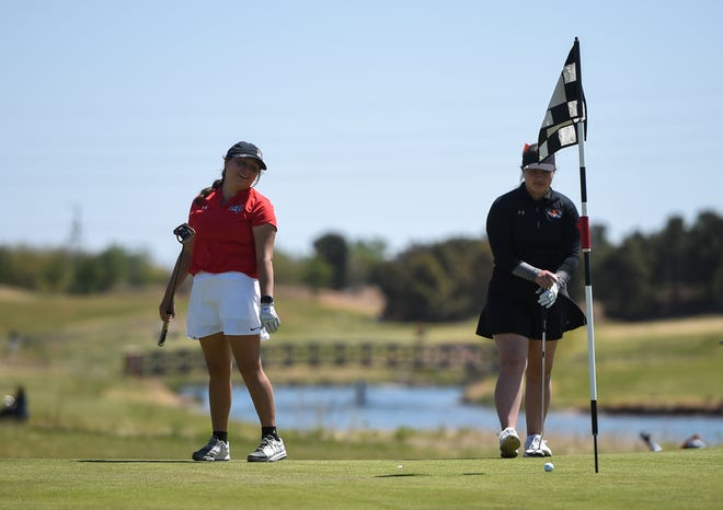 Lubbock-Cooper's Macey Goodblanket reacts to missing a putt during the Region I-5A girls' golf tournament on Monday at the Rawls Golf Course.