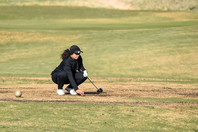 Lubbock High's Andrea Bedell sets up her tee shot during the Class 5A Girls' Regional golf tournament on Monday at Rawls Golf Course.