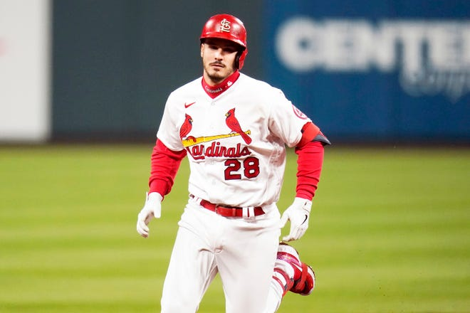 St. Louis Cardinals' Nolan Arenado rounds the bases after hitting a two-run home run during the third inning of a baseball game against the Washington Nationals Tuesday, April 13, 2021, in St. Louis.
