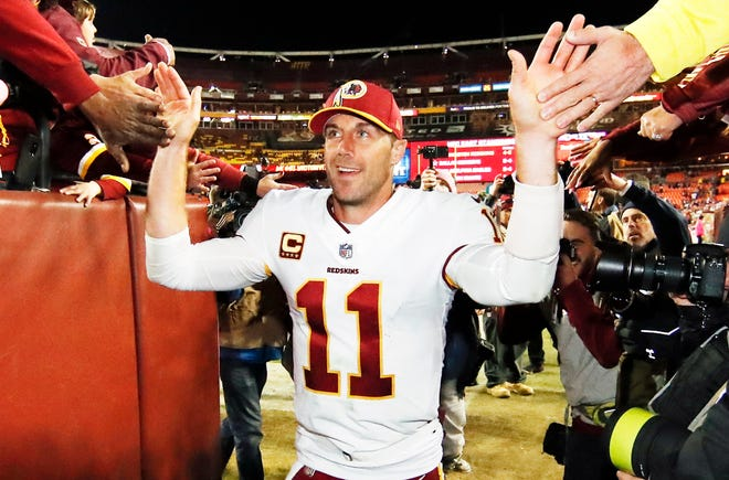 FILE - Washington Redskins quarterback Alex Smith (11) celebrates with fans after an NFL football game against the Dallas Cowboys in Landover, Md., in this Sunday, Oct. 21, 2018, file photo.