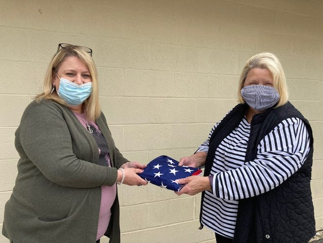 The American Legion Auxiliary Unit #6 President Jan Armstrong (R) presented a new American flag to Tammy Hudson, Administrator of Country View Nursing Center to replace their tattered flag on Friday.