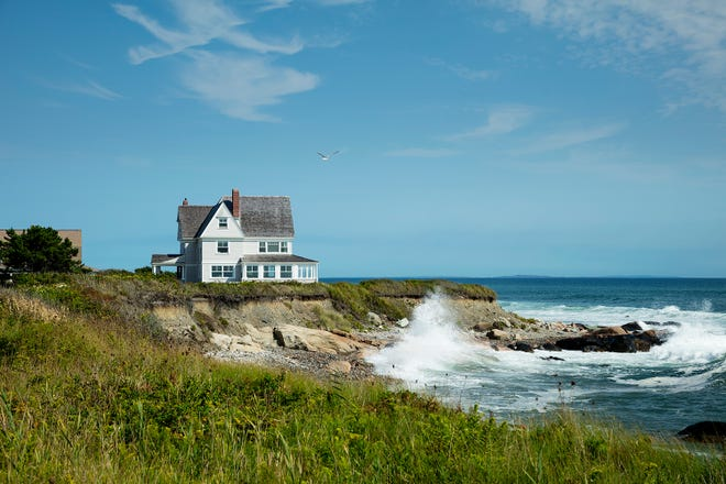 Set at the edge of a promontory, the early-20th-century house enjoys expansive water views on three sides.