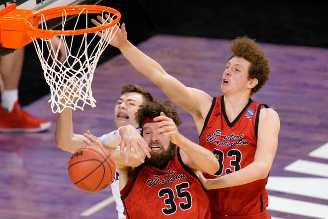 Kansas guard Christian Braun, left, battles Eastern Washington's Tanner Groves (35) and Jacob Groves (33) for a rebound on March 20.
