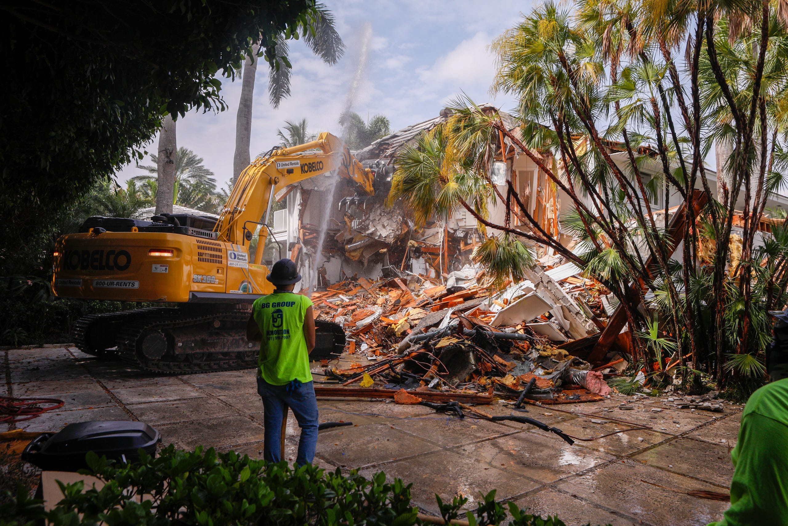 A crew from BG Group Demolition begins razing the Palm Beach home of late financier and sex offender Jeffrey Epstein, April 19, 2021.