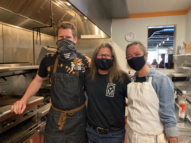 Seacoast-area chefs Norm Owens, left, Michele Duval and Mel Harrington have become a team, cooking community meals for Table of Plenty, feeding nearly 200 people in Kittery and Berwick for free and cooking at Dover's Chapel + Main restaurant.