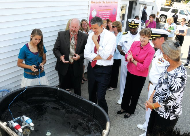 Angela Hampson, then a 15-year-old Portsmouth High student, leads a SeaPerch demonstration for former U.S. Secretary of Education, the Honorable Arne Duncan, U.S. Senator Jeanne Shaheen, shipyard leadership, and local school superintendents, as part of the 2010 PNS Youth Center Tour in 2010.
