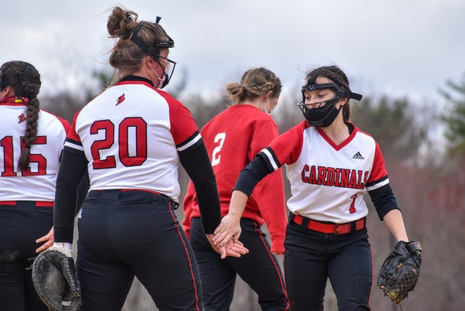 Pocono Mountain East teammates Shelby Jurasits (left) and Morgan Smith (right) complete a handshake at the start of the bottom of the fourth inning against East Stroudsburg North in Dingmans Ferry on Friday, April 16, 2021. East took down North, 19-5.