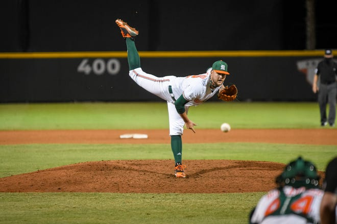 University of Miami's Jake Garland delivers a pitch during a game this season. Before college, Garland starred for Jupiter High School.