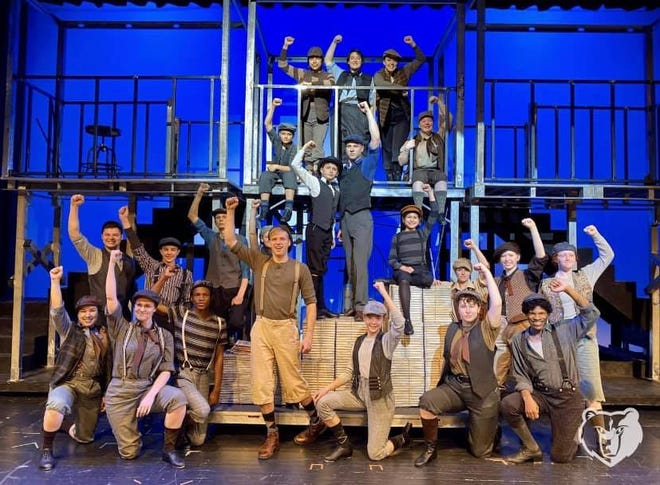 The 'Newsies' of the musical stand up for more just pay, as they sing in the musical playing at Barclay College.