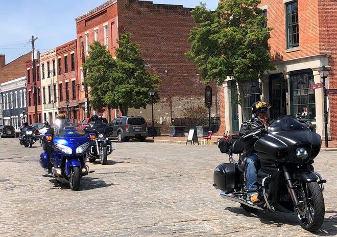 Bikers ride through Old Towne Petersburg on April 17, 2021.