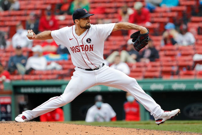 Boston's Nathan Eovaldi delivers against the Chicago White Sox during the fifth inning at Fenway Park on Monday. The Red Sox won, 11-4.