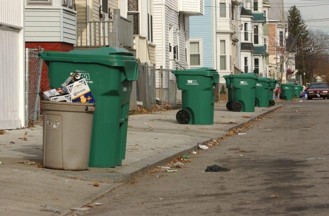 Trash bins line a street in Providence.