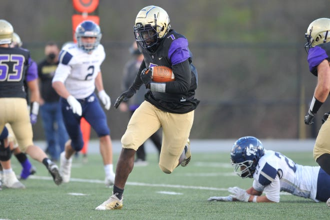 St. Raphael's Moses Meus races 34 yards for a touchdown, one of two he had in the Saints' shutout win over Moses Brown.