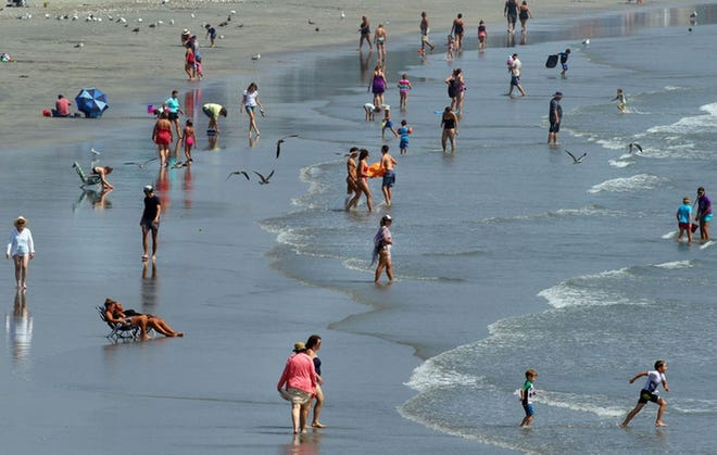 People enjoy the water at Easton's Beach in Newport on a warm summer afternoon in 2018.
