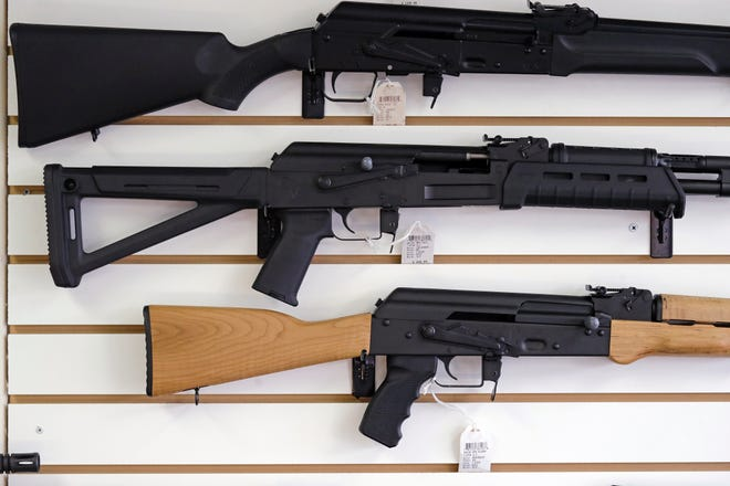 Semi-automatic rifles are displayed on a wall at a gun shop in Lynnwood, Wash., Oct. 2, 2018. Lawmakers in Oregon are considering a proposed gun storage law that would be the among strongest in America.