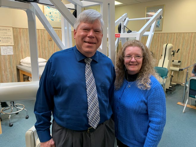 Jesse White, left, a physical therapist from Alliance, is sharing his story about battling severe COVID-19 symptoms. He is shown in this photo with his wife Ann.